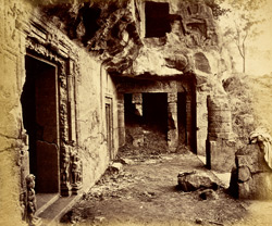 View from the left looking along interior of verandah of Buddhist chaitya hall, Cave XXVI, Ajanta, entrance doorway in left foreground, and 'chapel' at right